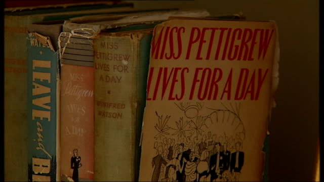 winifred watson novels on shelf and inside sleeve of 'miss pettigrew lives for a day' book - sleeve stock videos & royalty-free footage