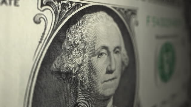 vídeos de stock e filmes b-roll de winking us one dollar note close up dolly shot - george washington