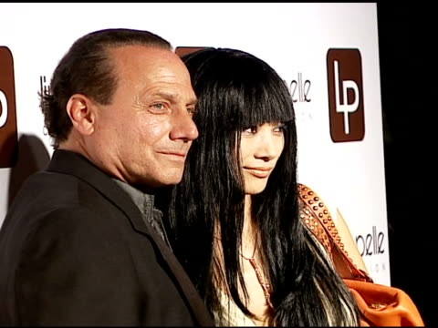 vídeos de stock, filmes e b-roll de winn katz and bai ling at the linea pelle 20th anniversay party at pacific design center in west hollywood, california on june 13, 2006. - bai ling