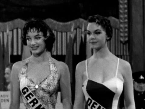 winner of 'miss world 1956' receives prize; england: london: int miss world contestants lined up, including the winner, miss germany and other... - miss world pageant stock videos & royalty-free footage