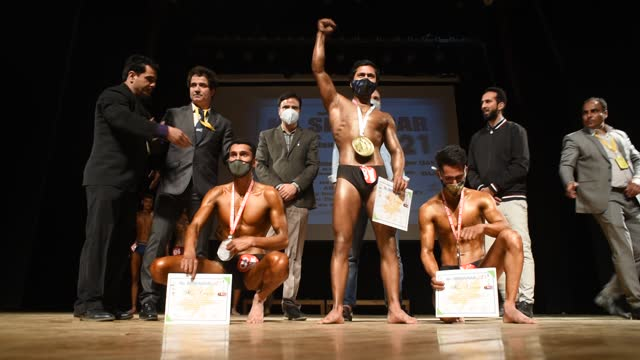 winners hold the trophies during the mr. srinagar bodybuilding competition organized by jammu and kashmir bodybuilding association, on april 04, 2021... - world sports championship stock videos & royalty-free footage