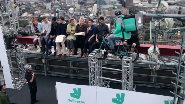 winners of a competition enjoy a meal 450ft up on the roof of a central london skyscraper as deliveroo recreates 'lunch atop a skyscraper' the... - lunch stock videos & royalty-free footage