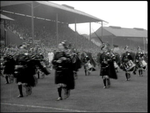 ireland football 'winners of all ireland football finals' sign posted in window ws pipe band marching in field crowd in balcony at stadium ha ws... - women's football stock videos & royalty-free footage