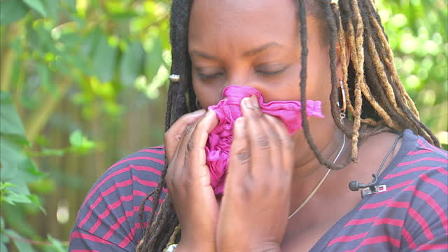 winnie crabb hayfever sufferer feeding fish in garden graphics showing hay fever rise exterior shots pollen researcher checking pollen measuring air... - hay fever stock videos and b-roll footage