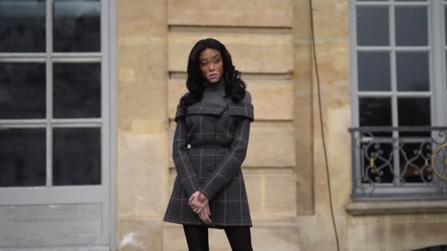 Winnie Harlow wears a gray wool turtleneck a checked pattern dress outside Dior during Paris Fashion Week Womenswear Fall/Winter 2018/2019 on...