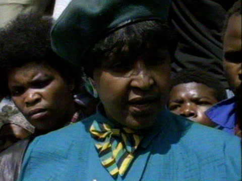 Winnie Mandela addresses a large crowd of followers since being charged with kidnap and assult