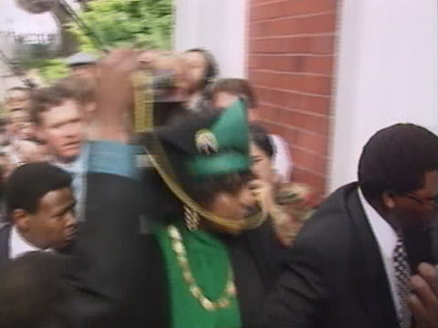 Winnie Mandela arrives at the South African parliament on the day that Nelson Mandela is elected the countries new president