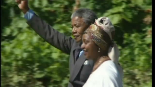 stockvideo's en b-roll-footage met winnie mandela faces questioning over possible murder inquiry date nelson mandela along with then wife winnie mandela - mogelijk