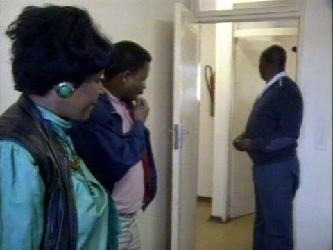 Winnie Mandela inside a local police station following charges of kidnap and assult