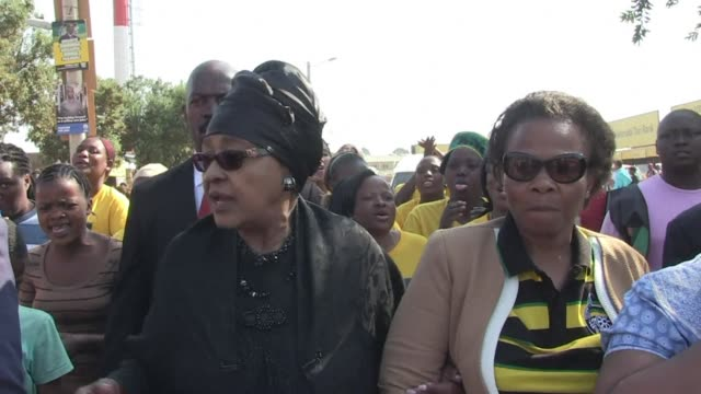 stockvideo's en b-roll-footage met winnie mandela visited the bekkersdal township just outside johannesburg after voting at the orlando west secondary school polling station in soweto - gauteng provincie