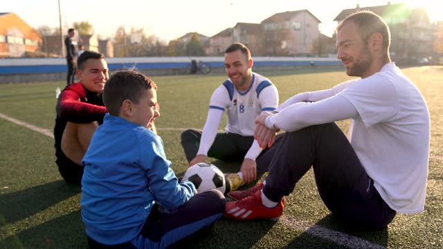 winning football players - sports team stock videos & royalty-free footage