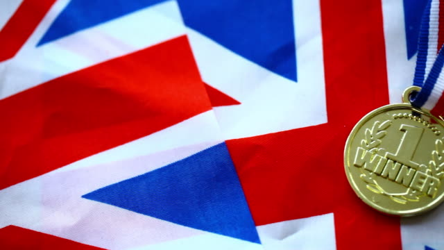 winning medal with british flag - medal stock videos & royalty-free footage