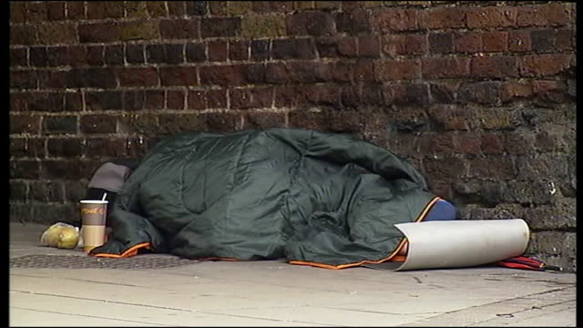 winning story for breaking into news competition focuses on the plight of young homeless londoners commuters along homeless person lying wrapped up... - polystyrene stock videos & royalty-free footage