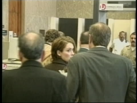 winona ryder and lawyer mark geragos walk in courthouse lobby - winona ryder stock videos & royalty-free footage