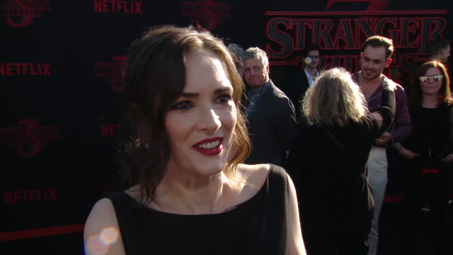 "winona ryder n how it felt to reunite with the cast to film this season at the ""stranger things"" season 3 world premiere in los angeles, ca 6/28/19 - season stock videos & royalty-free footage"
