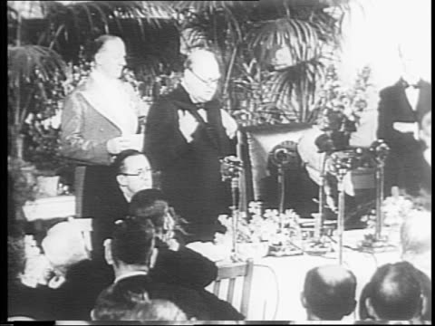 winston churchill addresses room full of allied diplomats at a dinner in london / exterior of the white house in washington dc / international... - court room stock-videos und b-roll-filmmaterial