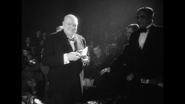 winston churchill and field marshall bernard montgomery step on stage together / eisenhower leans across wife mamie and shakes churchills hand /... - 1951 bildbanksvideor och videomaterial från bakom kulisserna
