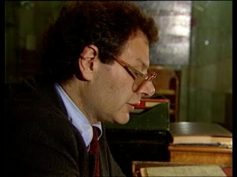 winston churchill biography: martin gilbert:; england: london: war cabinet rooms: int bv historian martin gilbert seated at desk cms side gilbert tms... - war stock-videos und b-roll-filmmaterial