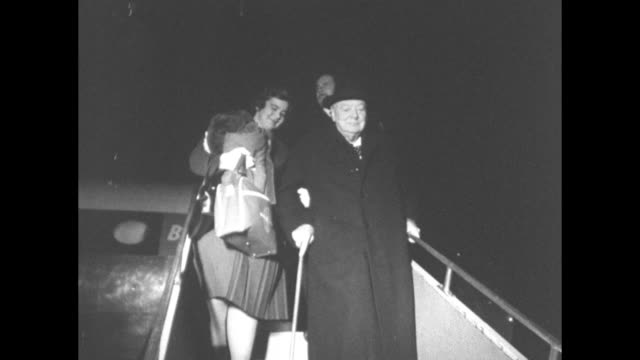 Winston Churchill gets off plane apparently in United States 1962