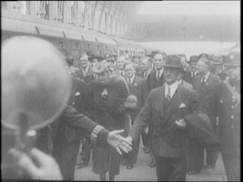 winston churchill returns to london, arrives at train station and exits train to crowds / aerial view of bermuda / churchill sitting in pilot seat,... - 1942 stock videos & royalty-free footage