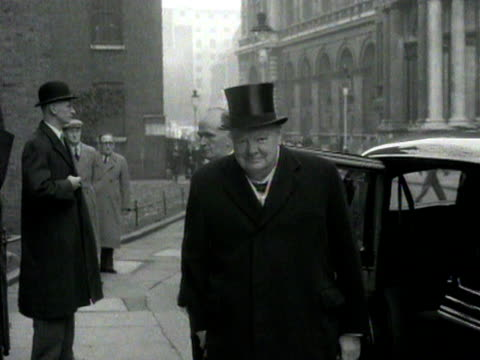 winston churchill stands next to a car then enters 10 downing street 1954 - winston churchill stock videos & royalty-free footage