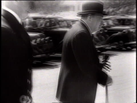 winston churchill walks from parking lot with sir torey lord of the admiralty / london united kingdom - film montage stock videos & royalty-free footage