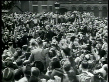 winston churchill waves at crowds as he drives through in london after his 1951 general election victory - 1951 bildbanksvideor och videomaterial från bakom kulisserna