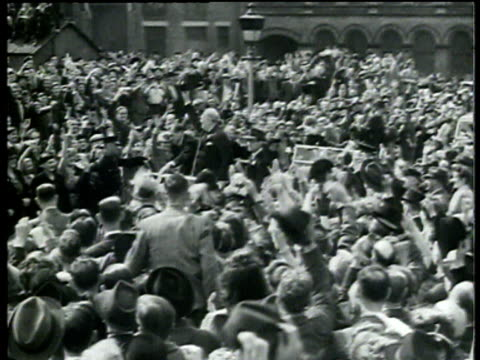 vídeos de stock, filmes e b-roll de winston churchill waves at crowds as he drives through in london after his 1951 general election victory - 1951