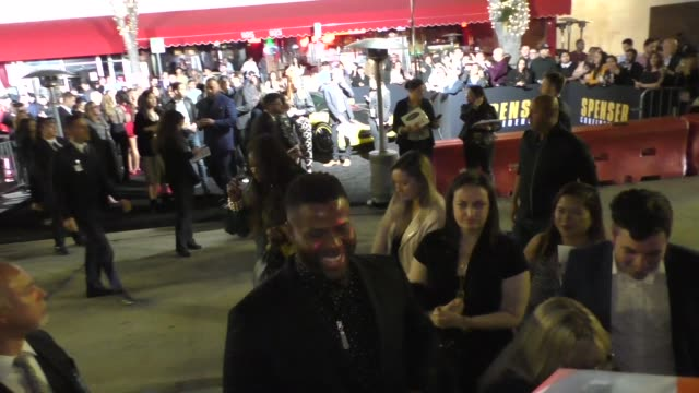 winston duke signs for fans outside the premiere of spenser confidential at westwood village theatre in westwood in celebrity sightings in los angeles - westwood neighborhood los angeles stock videos & royalty-free footage