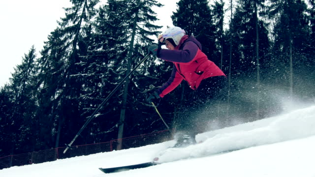 winter activities. woman fast skiing on a fresh snow - ski goggles stock videos & royalty-free footage