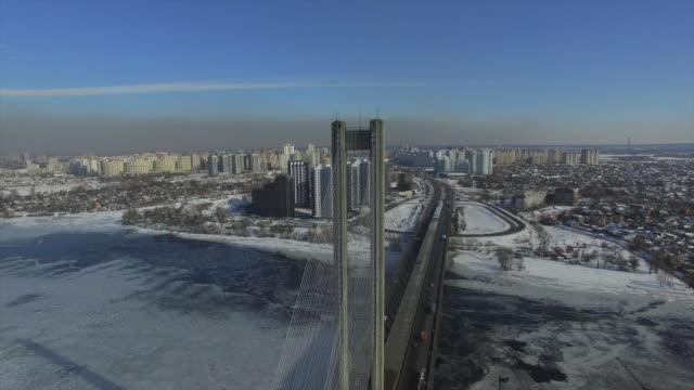 winter aerial view of kiev city southern bridge - urban sprawl stock videos & royalty-free footage