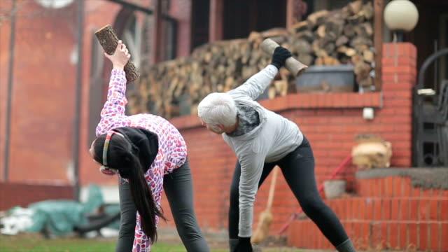 winter aerobics - stretching stock videos & royalty-free footage