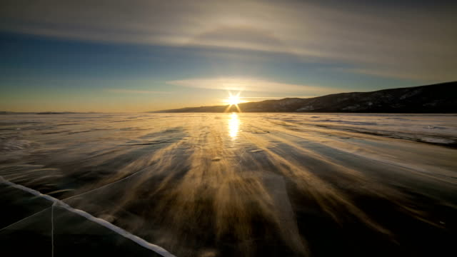winter baikal. strong wind on the ice, drifting snow. timelapse - icicle stock videos and b-roll footage