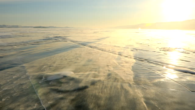Winter Baikal. Strong wind on the ice, drifting snow