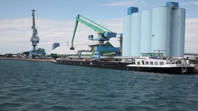 winter barley is seen being unloaded from the cargo barge 'poseidon' during operations at tellines port operated by the marseillefos port authority... - saint louis bildbanksvideor och videomaterial från bakom kulisserna