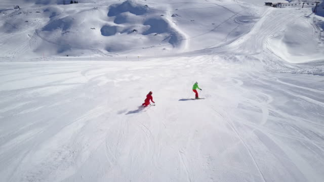 Winter Breaks, 4k aerial skiing couple