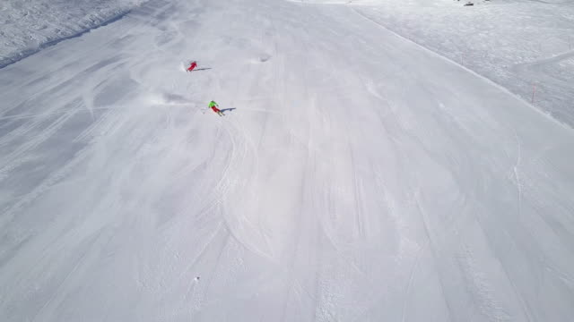 winter breaks, 4k aerial skiing on empty ski slope - ski slope stock videos and b-roll footage