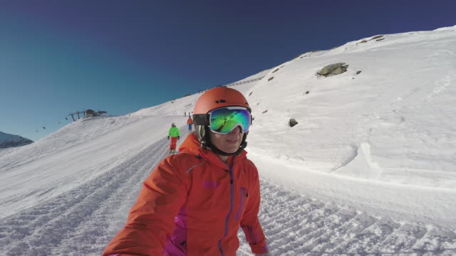 winter breaks, selfie point of view four skiers on ski slope - sports helmet stock videos & royalty-free footage