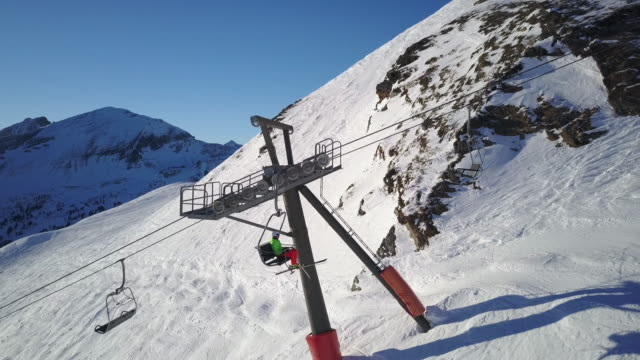 winter breaks, skier on chair ski lift drone view - ski lift point of view stock videos & royalty-free footage