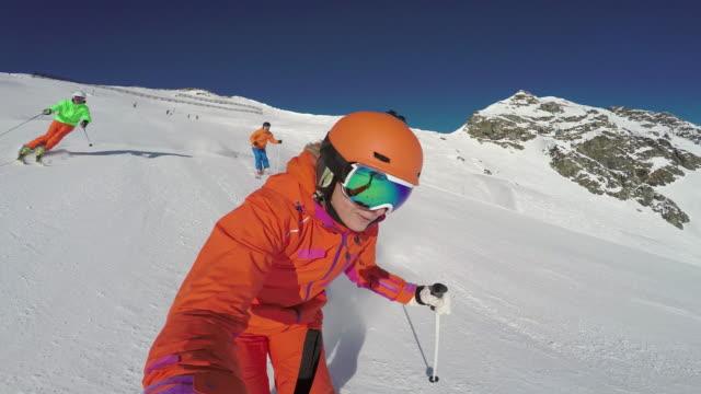 winter breaks, sunshine skiing selfie point of view - ski jacket stock videos & royalty-free footage