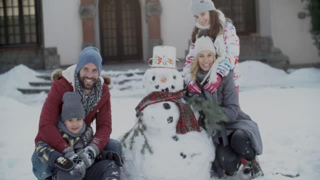 winter breaks - making a snowman stock videos & royalty-free footage