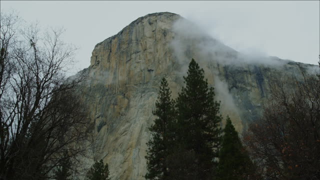 Winter clouds timelapse against Yosemite mountain
