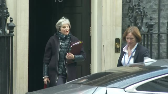 MPs debate NHS funding London Downing Street EXT Prime Minister Theresa May MP from Number 10 to car