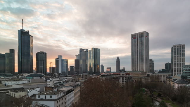 A winter day to night time lapse of the central Frankfurt am Main skyline (Germany) with fast moving, heavy cloud cover overhead