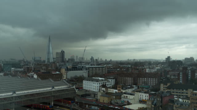 a winter day to night time lapse of the shard (london, uk)  featuring fast moving clouds carrying a heavy downpour of rain across the cityscape that fades as night falls - filiz stock videos & royalty-free footage