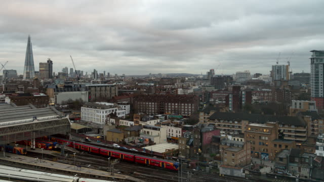 A winter day to night time lapse of Waterloo Station (London, UK) featuring trains arriving and departing with views of the Shard and multiple cranes in action in the background and heavy clouds overhead