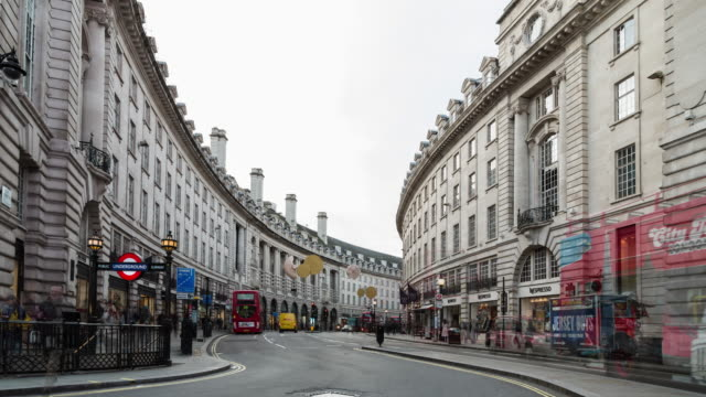 A winter daytime time lapse of foot and vehicle traffic on Regent Street taken from Piccadilly Circus featuring the entry to the Piccadilly Circus underground station