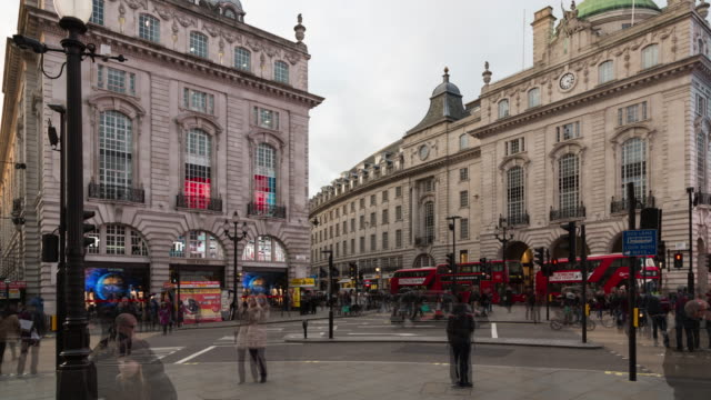 A winter daytime time lapse of foot and vehicle traffic taken from the center of Piccadilly Circus in London, UK
