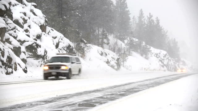 winter driving hazardous snow blizzard conditions - slippery stock videos & royalty-free footage