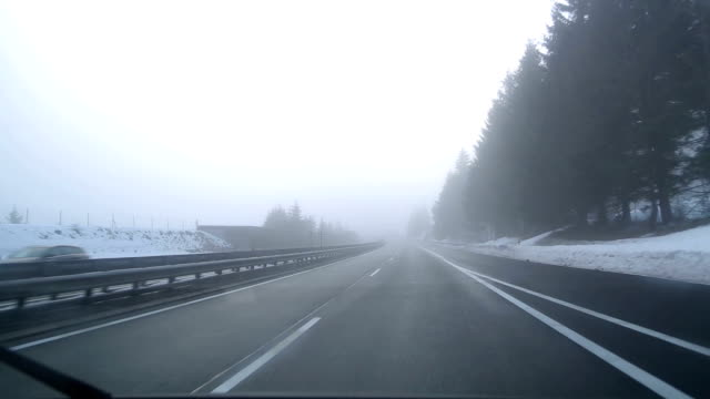 winter driving in austria - windshield stock videos & royalty-free footage